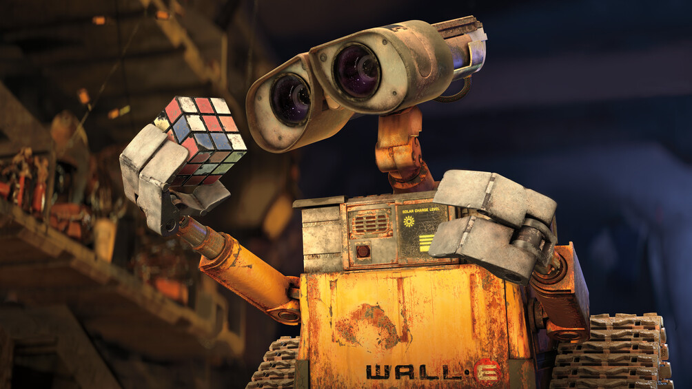 Wall-E ist mit einem Zauberwürfel in der Hand abgebildet.