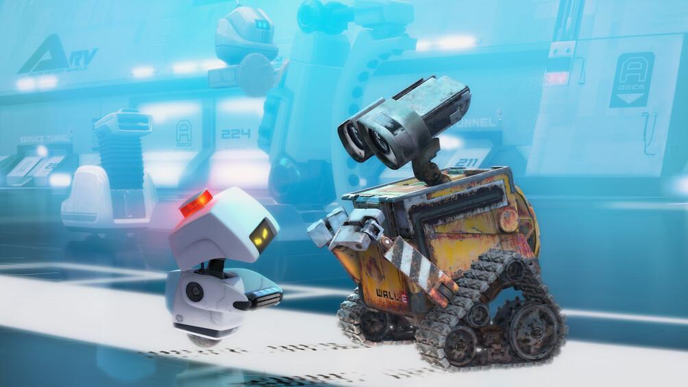 Der Roboter Wall-E ist mit einem anderen Roboter vor blauem Hintergrund zu sehen.