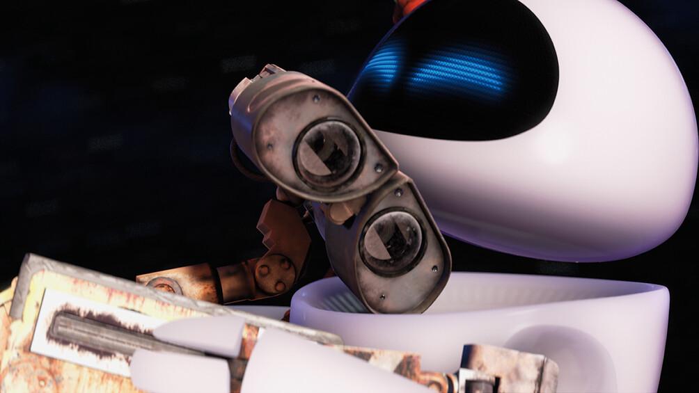 Die Roboter Wall-E und Eve umarmen sich.